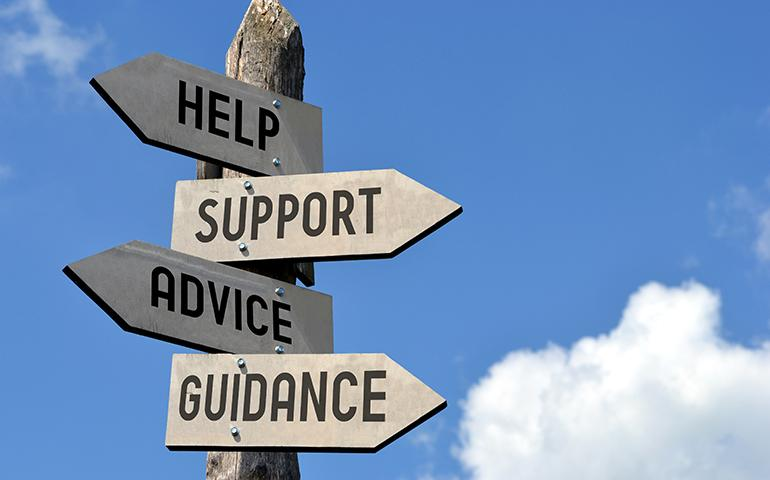 Image of a sign with multiple directional signs titled Help, Support, Advice and Guidance.